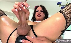 Shemale Gina Hart stuffed her ass with a big black dildo