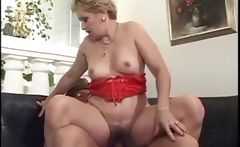 Old blonde granny gets fingered and blows an old black guy before fucking him