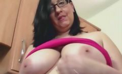 Jane Storm is a chunky babe in glasses who masturbates on the kitchen counter top