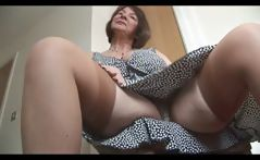 Busty mature brunette does a little striptease showing hairy pussy