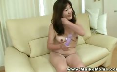 Oriental mature tramp shows her body then massages her clit
