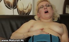 Horny mature is rubbing her pussy