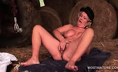 Big titted mature slut self fucking with giant dildo in a